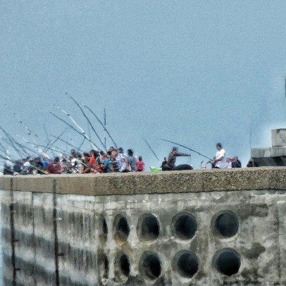 Vissende mannen in Dieppe